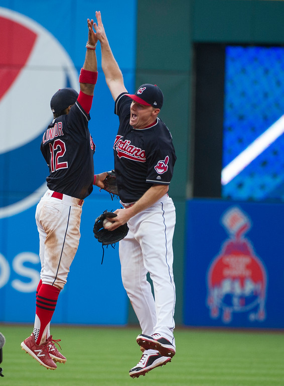 . Cleveland Indians\' Jay Bruce, right, celebrates with Cleveland Indians\' Francisco Lindor after beating the Kansas City Royals 8-4 after a baseball game in Cleveland, Saturday, Sept. 16, 2017. (AP Photo/Phil Long)