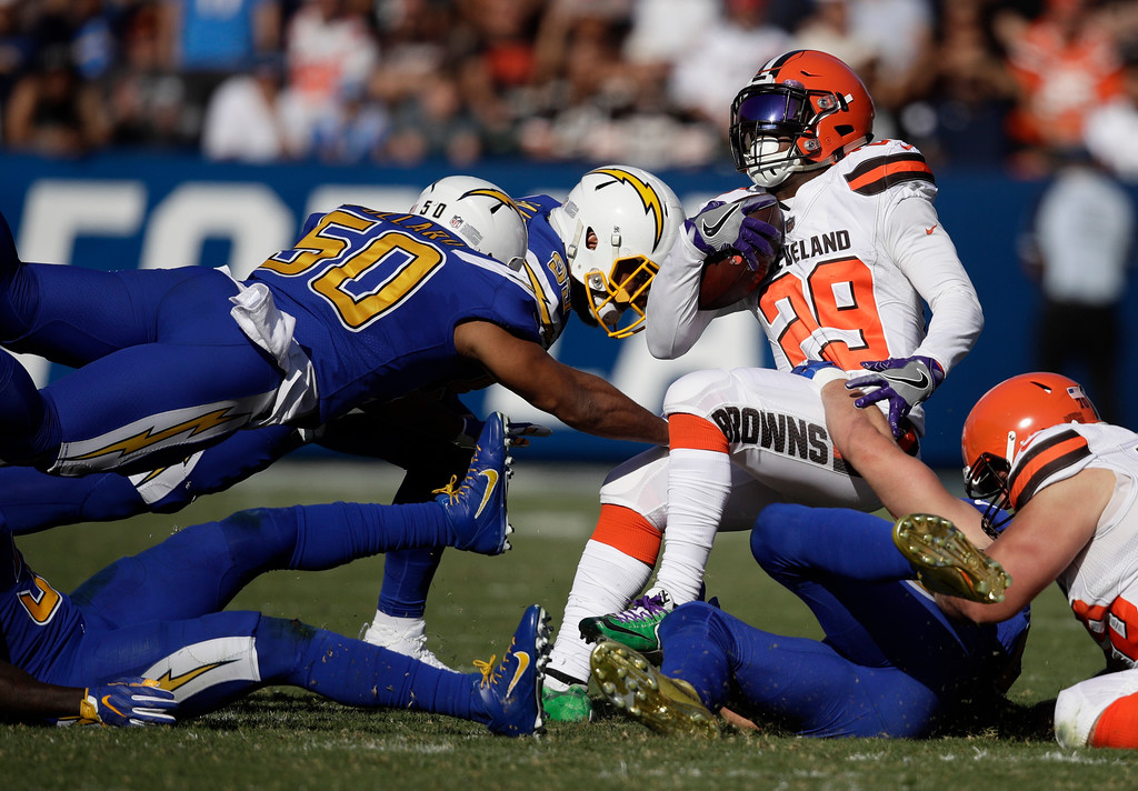 . Cleveland Browns running back Duke Johnson (29) is tackled during the first half of an NFL football game against the Los Angeles Chargers Sunday, Dec. 3, 2017, in Carson, Calif. (AP Photo/Jae C. Hong)
