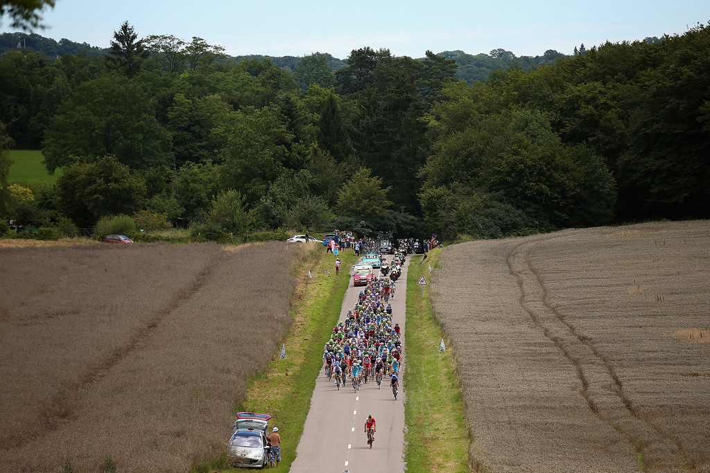 . The peloton in action during the eleventh stage of the 2014 Tour de France, a 188km stage between Besancon and Oyonnax, on July 16, 2014 in Oyonnax, France.  (Photo by Bryn Lennon/Getty Images)