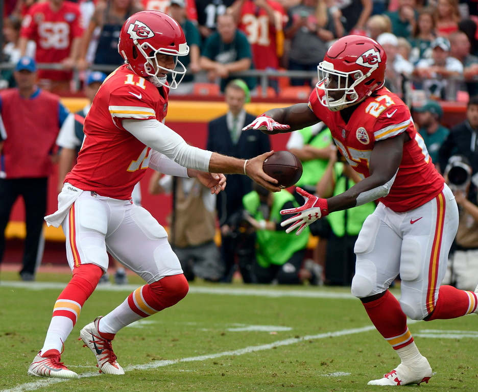 . Kansas City Chiefs quarterback Alex Smith (11) hands the ball off to running back Kareem Hunt (27) during the first half of an NFL football game against the Philadelphia Eagles in Kansas City, Mo., Sunday, Sept. 17, 2017. (AP Photo/Ed Zurga)