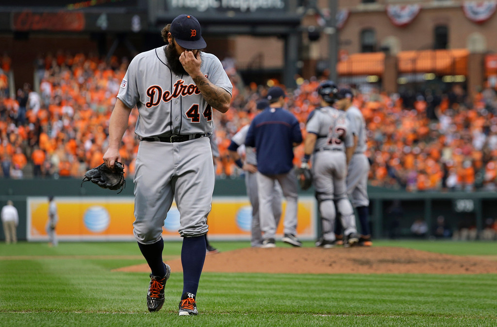. Detroit Tigers relief pitcher Joba Chamberlain walks off the field after being relieved in the eighth inning of Game 2 in baseball\'s AL Division Series against the Baltimore Orioles in Baltimore, Friday, Oct. 3, 2014. Baltimore won 7-6. (AP Photo/Patrick Semansky)