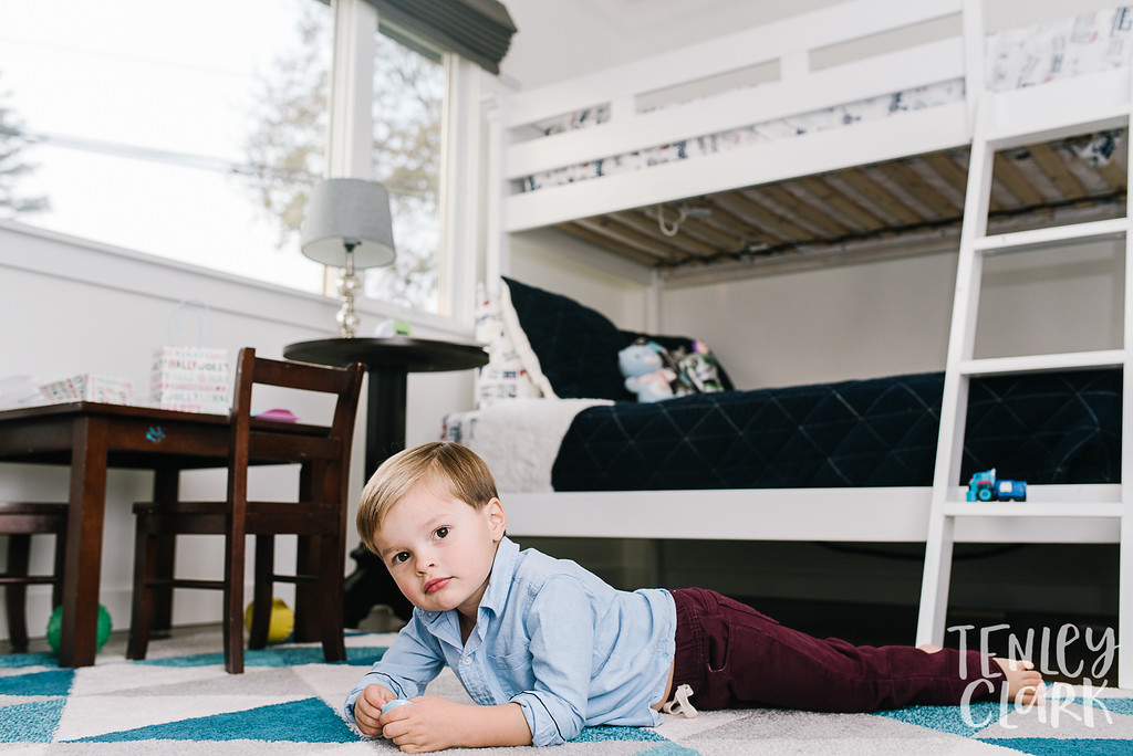 Little boy in his room. Lifestyle in-home family photoshoot in Marin, CA by Tenley Clark Photography.