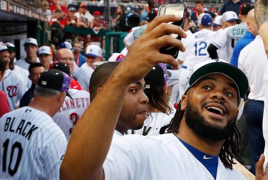 . Los Angeles Dodgers pitcher Kenley Jansen takes a selfie before the Major League Baseball All-Star Game, Tuesday, July 17, 2018, in Washington. (AP Photo/Alex Brandon)