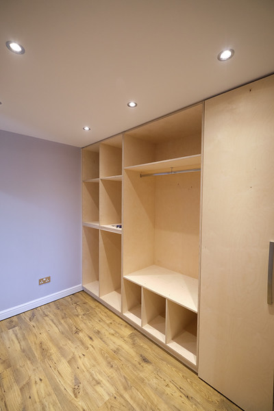 18mm Birch ply storage units, adjustable shelve section on left, hanging and boot storage to middle and covered general storage to right.
