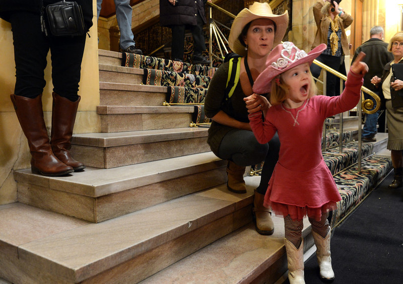 . DENVER, CO. - JANUARY 25:  Angela Forster and her daughter Lena, 4, visit the National Western Stock Show\'s Grand Champion and Reserve Steers at the Brown Palace Hotel & Spa in Denver, CO, January, 25, 2013. The Grand Champion ,Trevor, weighing in at 1335 lbs. was raised by Shilo Schaake of Westmoreland, KS. The Reserve Grand Champion, Nick, 1275 lbs, was shown by  Jessica Webster of Runnells, IA. (Photo By Craig F. Walker / The Denver Post)
