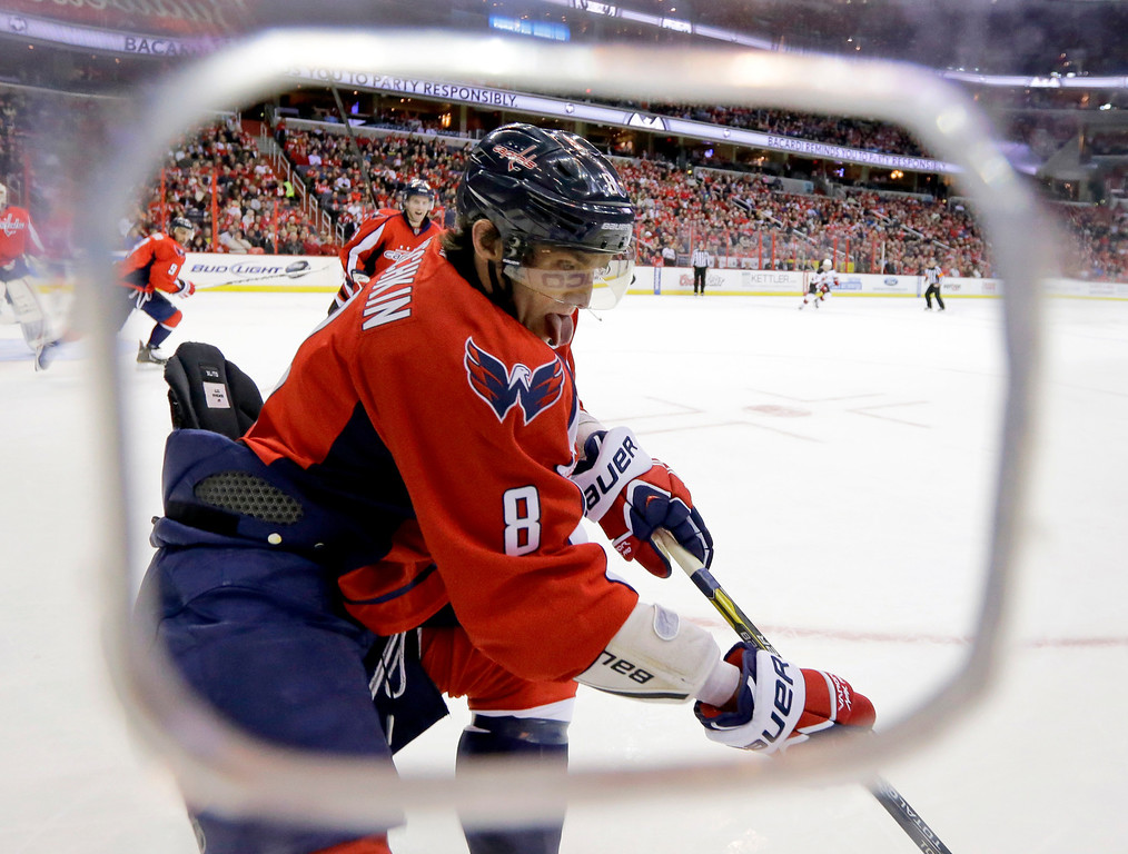 . Washington Capitals left wing Alex Ovechkin (8), of Russia, goes for the puck in the first period of an NHL hockey game against the New Jersey Devils, Thursday, Feb. 21, 2013, in Washington. The Devils won 3-2. (AP Photo/Alex Brandon)