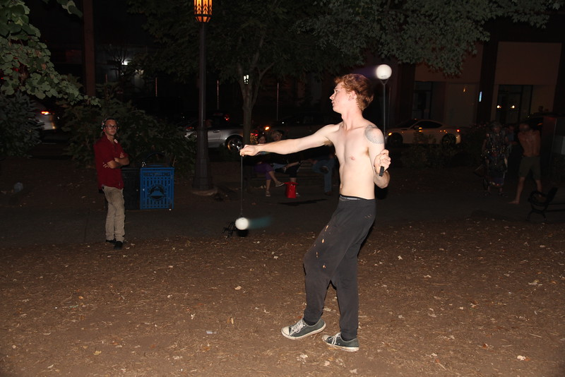 street performer throwing around his glow in the dark balls