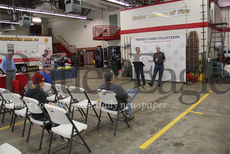 Craig McMillen, left, and Rich Wilson with the Pennsylvania Volunteers address a mostly empty room for the first flood disaster workshop on Saturday. Photo by Eric Jankiewicz
