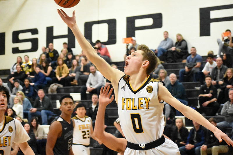 Madison Heights Bishop Foley senior guard Matt Brady drives to the basket Friday night in his team's 67-57 loss to Cranbrook. (Digital First Media photo by Jason Schmitt)