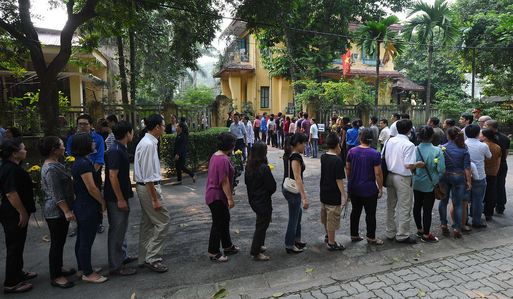 . People line up in the compound of late General Vo Nguyen Giap\'s residence to pay homage to him, as thousands of people flocked to pay last tribute to the national independence hero in Hanoi on October 6, 2013. Vietnam announced plans to hold a national funeral for independence hero General Vo Nguyen Giap in the first official statement on the death of the ruthless but brilliant military strategist.  HOANG DINH NAM/AFP/Getty Images