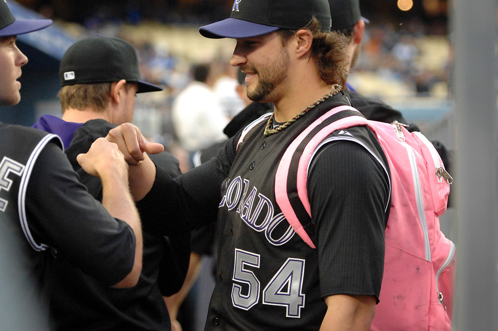 . Rockies rookie pitcher Tommy Kahnle carries a pink backpack in the dugout before the game against the Dodgers, Friday, April 25, 2014, at Dodger Stadium. (Photo by Michael Owen Baker/L.A. Daily News)