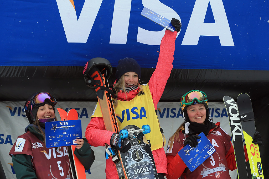 . Darian Stevens of the United States in second place, Dara Howell of Canada in first place and Grete Eliassen of the United States in third place, take the podium for the women\'s FIS Slopestyle Ski World Cup at the U.S. Snowboarding and Freeskiing Grand Prix on December 21, 2013 in Copper Mountain, Colorado.  (Photo by Doug Pensinger/Getty Images)
