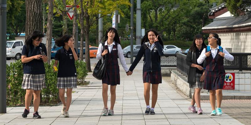 Schoolgirls walking on walkway, Seoul, South Korea