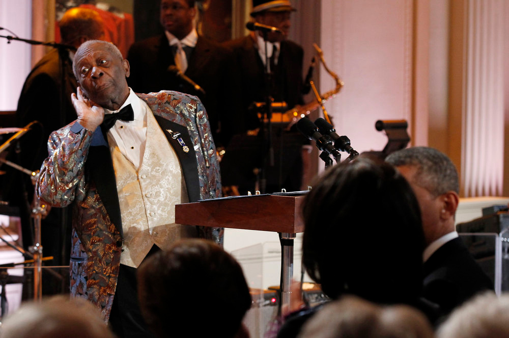 Description of . B.B. King, left, performs during the White House Music Series saluting Blues Music in recognition of Black History Month, Tuesday, Feb. 21, 2012, in the East Room of the White House in Washington. (AP Photo/Pablo Martinez Monsivais)