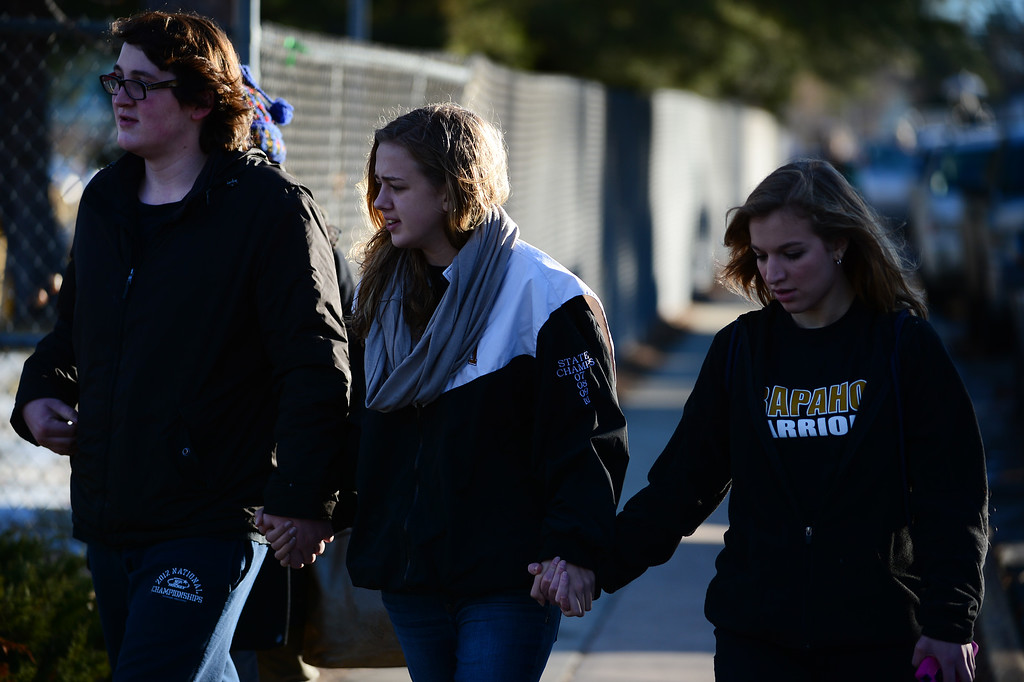 . Students, friends and family arrive at Arapahoe High School for a prayer circle on the track of the school to pray for shooting victim Claire Davis in Centennial, CO on December 15, 2013. Students from the high school attended the prayer service to pray for the recovery of Davis who was shot during the recent shooting at the high school and remains in critical condition. (Photo By Helen H. Richardson/ The Denver Post)
