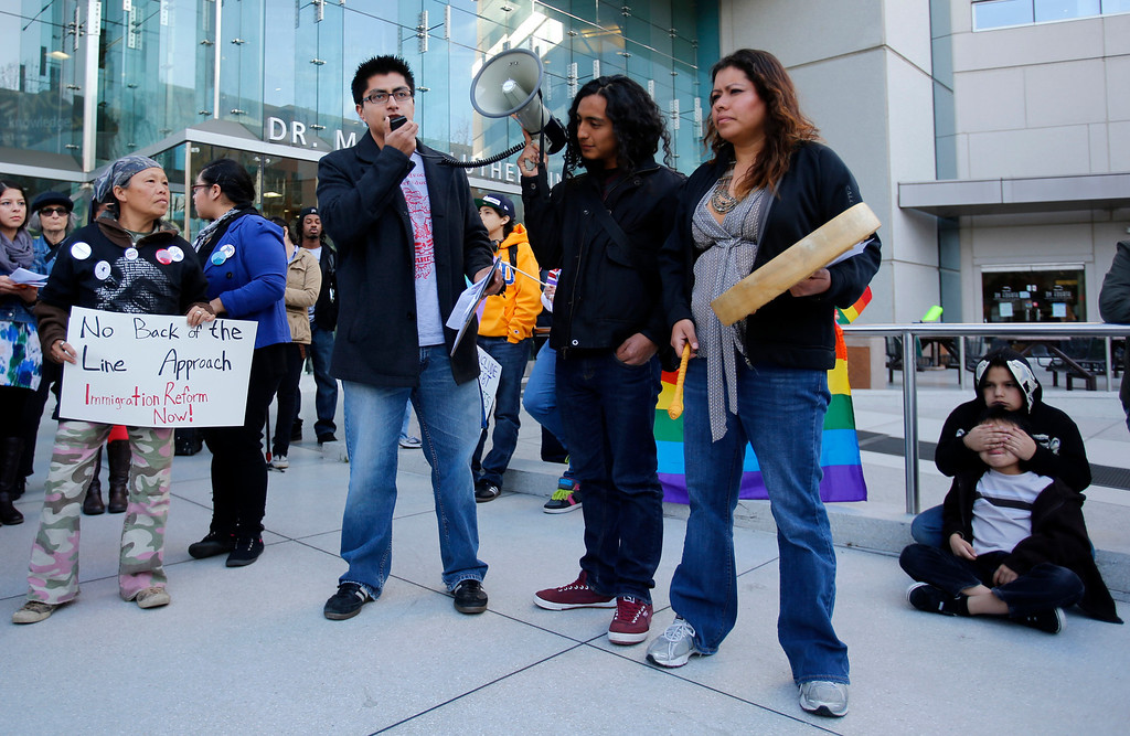 ". Protestors speak in front of the Dr. Martin Luther King Jr. Library during an ""Immigration Reform Now\"" rally in San Jose, Calif., on Thursday, Feb. 21, 2013.  They were protesting comprehensive immigration reform.  They began at Dr. Martlin Luther King, Jr. Library and ended at the Robert F. Peckham Federal Building.  (Nhat V. Meyer/Staff)"