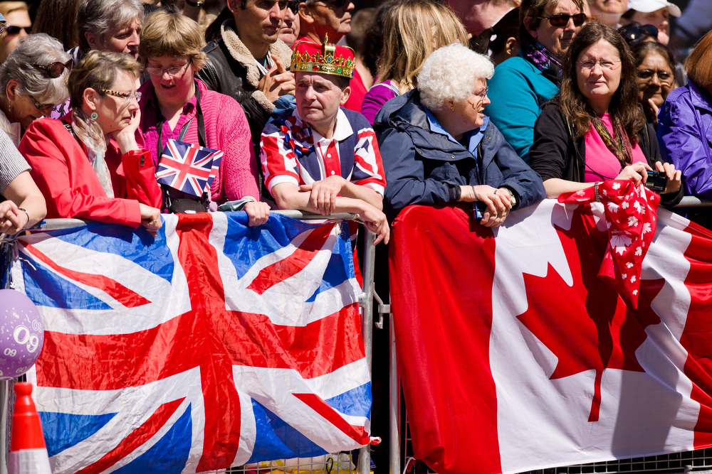 . Britain\'s Union flag (L) is pictured beside the Canadian flag as members of the public wait outside Westminster Abbey in London, on June 4, 2013, for the start of a service to celebrate the 60th anniversary of the Coronation Service. Britain\'s Queen Elizabeth II, now 87, took the throne on February 6, 1952 upon the death of her father king George VI, but to allow for a period of national mourning she was only crowned on June 2, 1953 in London\'s Westminster Abbey.  LEON NEAL/AFP/Getty Images