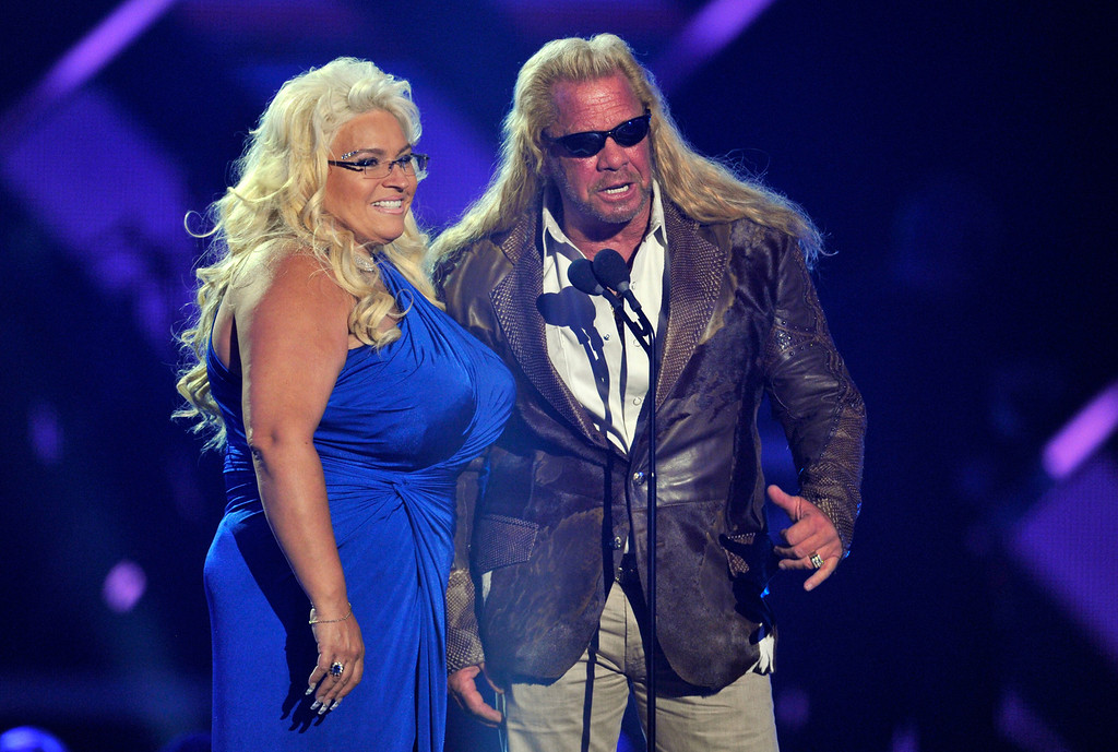 ". Duane ""Dog\"" Chapman, right, and Beth Chapman present the award for CMT performance of the year at the 2013 CMT Music Awards at Bridgestone Arena on Wednesday, June 5, 2013, in Nashville, Tenn. (Photo by Donn Jones/Invision/AP)"