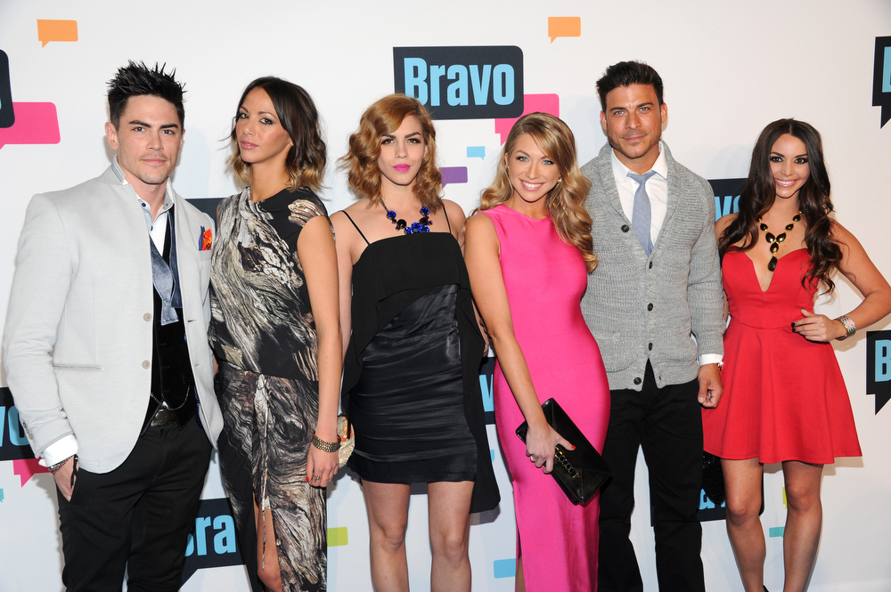 ". The cast of ""Vanderpump Rules\"", from left, Tom Sandoval, Kristen Doute, Katie Marie Maloney, Stassi Schroeder, Jax Taylor and Scheana Marie attend the Bravo Network 2013 Upfront on Wednesday April 3, 2013 in New York. (Photo by Evan Agostini/Invision/AP)"