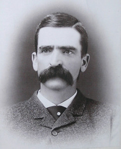 "For all of his many endeavors, Seth Bullock identified himself as a ""Miner"" in the 1890 Deadwood City Directory.    He and Star had invested in several mining ventures, particularly the Iron Hill Mine.  He had been a director since 1883 and was listed as its President by 1885.  During a seven-year period, the mine reportedly produced $725,000 in silver bullion.   Nonetheless, steep expenses left Bullock netting only about $600 during that entire time.  As characterized by Woll in his presentation, Bullock ""lost his shirt on the Iron Hill Mine.""  The 20th century held new directions for Bullock, as he entered what Wolff calls his ""public service era.""  Bullock's long-standing friendship with President Theodore Roosevelt resulted in -- among other things -- Bullock's appointment as supervisor of the Black Hills Reserve, a Colonel with TR's ""Rough Riders,"" and an appointment as U. S. Marshall for South Dakota.  Thanks to the Adams Museum and House for use of this photo."