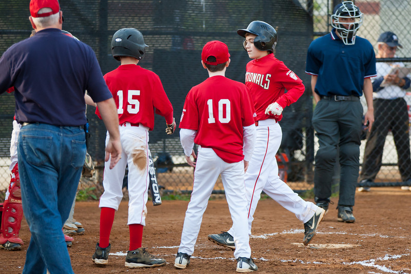 John hits a HOME RUN with Mac on 2nd base in the top of the 3rd inning. Nats lead 5-0. The Nationals almost blew a big lead, but managed to hold off the Brewers to win 9-7. They are now 3-2 for the season. 2012 Arlington Little League Baseball, Majors Division. Nationals vs Brewers (26 Apr 2012) (Image taken by Patrick R. Kane on 26 Apr 2012 with Canon EOS-1D Mark III at ISO 800, f2.8, 1/1250 sec and 160mm)