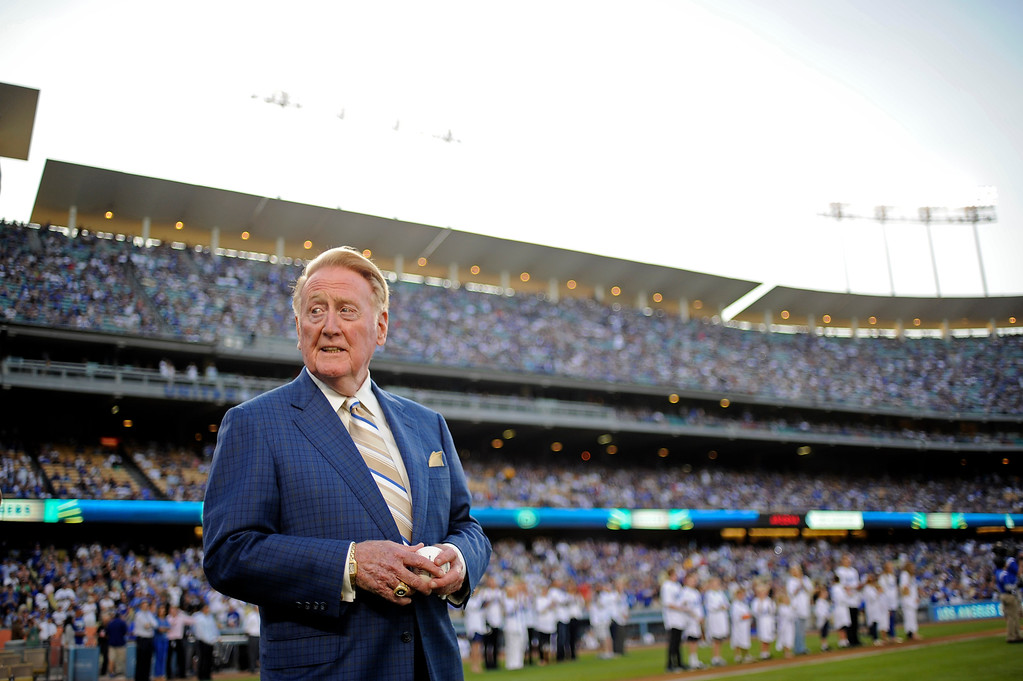 . Vin Scully waits to throw out the first pitch on  Vin Scully Bobblehead Night at Dodger Stadium in Los Angeles Thursday, August 30, 2012. (Hans Gutknecht/Los Angeles Daily News)