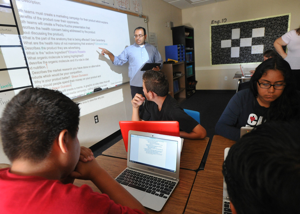 . Students listen to biology teacher Miguel Espinoza as they work with their laptops as part of the CORE program at Nogales High School in Rowland Heights on Wednesday September 18, 2013. CORE, the Creation Of Revolutionary Education, is a program that provides a small learning community centered around Technology, Science and English. (San Gabriel Valley Tribune/Staff Photo by Keith Durflinger)