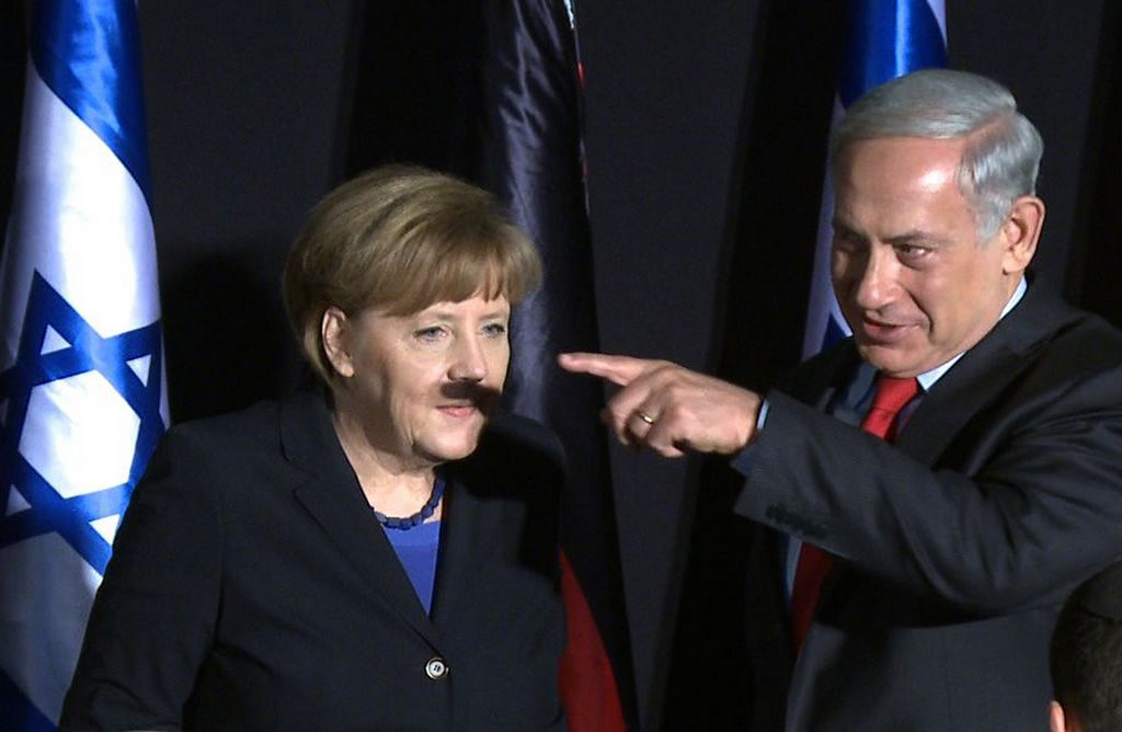 ". <p><b> An unfortunately-timed photo of Angela Merkel includes a shadow that appears to give the German chancellor a moustache just like � </b> <p> A. Adolf Hitler�s <p> B. Josef Stalin�s <p> C. Rosie O�Donnell�s <p><b><a href=\'http://www.mirror.co.uk/news/world-news/german-leader-angela-merkel-given-3185406\' target=""_blank\"">HUH?</a></b> <p>      (Yoav Lemmer/AFP/Getty Images)"