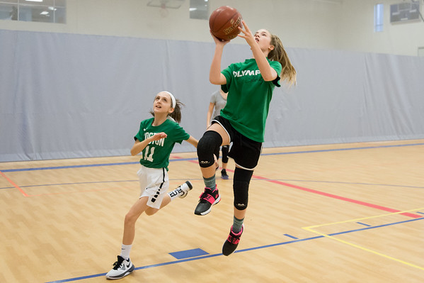02/011/19 Wesley Bunnell | Staff Members of the girls 7th and 8th grade St. Joseph's basketball team practiced at the Bristol Boys and Girls Club on Monday afternoon. Quinn Burns, L, guards Anna Kronen as she attempts a shot.