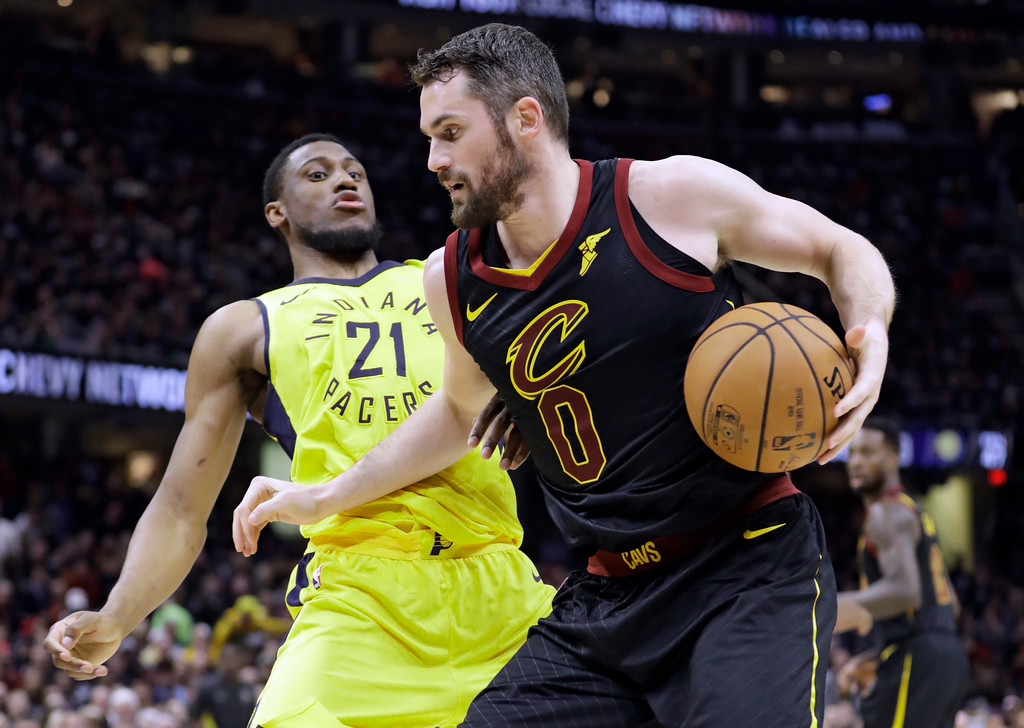 . Cleveland Cavaliers\' Kevin Love (0) drives to the basket against Indiana Pacers\' Thaddeus Young (21) in the first half of a first-round playoff series in an NBA basketball game, Sunday, April 15, 2018, in Cleveland. (AP Photo/Tony Dejak)