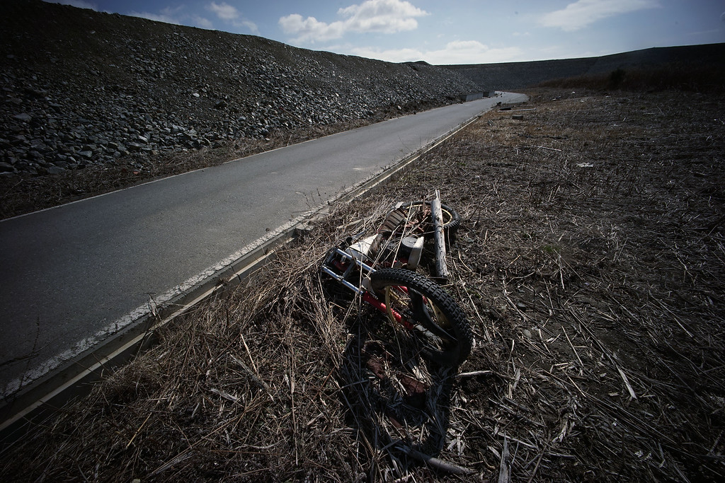 . In this Friday, March 6, 2015 photo, a damaged motorcycle  is left  on the side of a road in the Tsunami damaged area in Rikuzentakata, Iwate Prefecture, northeastern Japan. (AP Photo/Eugene Hoshiko)
