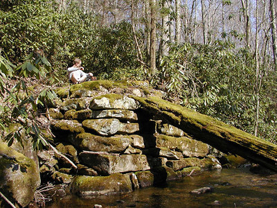 Dan sits at the old bridge crossing of Thunderhead Prong