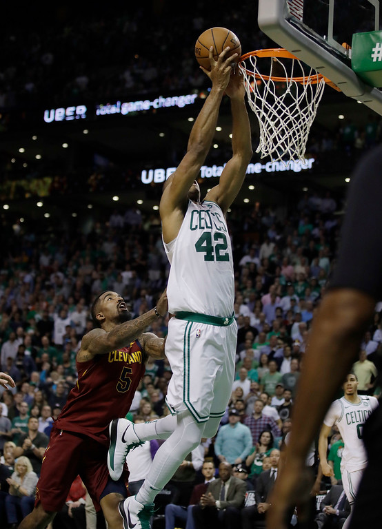 . Cleveland Cavaliers guard JR Smith, left, shoves Boston Celtics forward Al Horford (42) as he drives to the basket during the second half in Game 2 of the NBA basketball Eastern Conference finals Tuesday, May 15, 2018, in Boston. Smith was called for a flagrant foul. (AP Photo/Charles Krupa)
