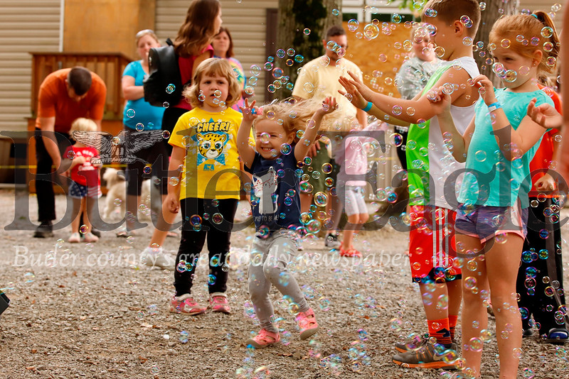 "Kids dance through bubbles during a dance party hosted by ""Bubble Lady"" DJ Beth Ryder at Yogi Bear's Jellystone Park at Kozy Rest over the weekend. Seb Foltz/Butler Eagle 083119"