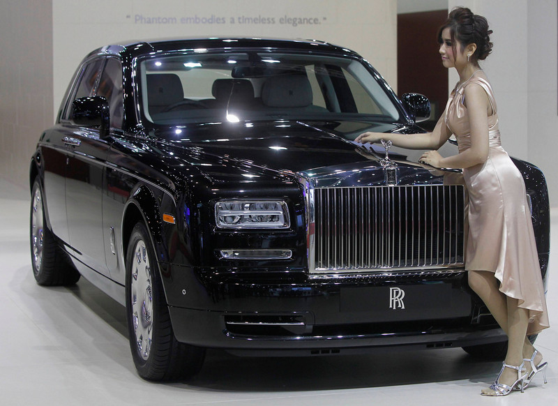 . A model poses beside a Rolls-Royce Phantom Standard Wheelbase during a media presentation of the 34th Bangkok International Motor Show in Bangkok March 26, 2013. The Bangkok International Motor Show will be held from March 27 to April 7. REUTERS/Chaiwat Subprasom