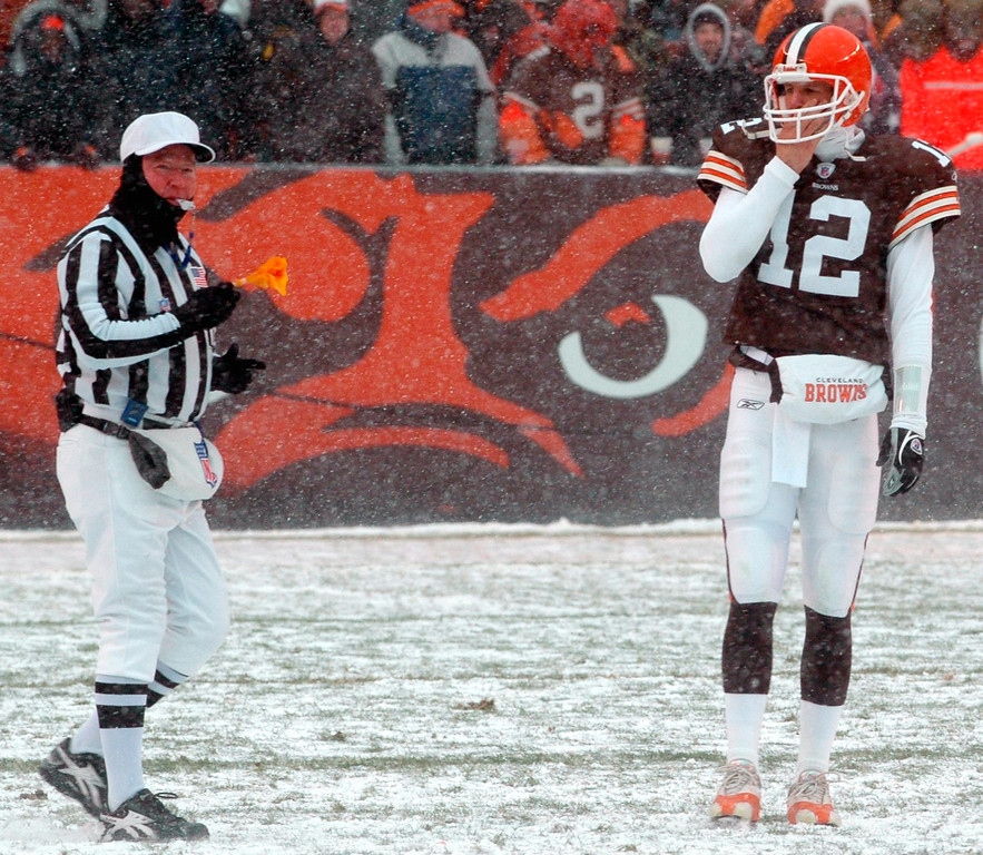 . News-Herald file Browns quarterback Luke McCown\'s expression says it  all as he can hardly bear to watch a penalty flag fly out of the hand of an official for an illegal man down field during the third quarter of Sunday\'s game at Cleveland Browns Stadium.