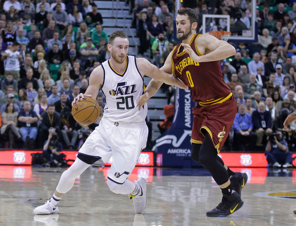 . Utah Jazz forward Gordon Hayward (20) drives around Cleveland Cavaliers forward Kevin Love (0) during the second half of an NBA basketball game Tuesday, Jan. 10, 2017, in Salt Lake City. The Jazz won 100-92. (AP Photo/Rick Bowmer)