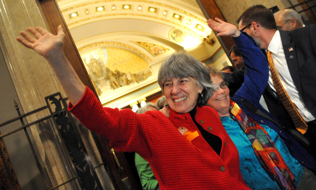 . Rep. Karen Clark, DFL- Minneapolis, left, and her partner Jacquelyn Zita wave to supporters as they leave the House chambers at the state Capitol on Thursday, May 9, 2013, after winning the House floor vote on a bill allowing same-sex couples to marry. Clark is the House sponsor of the bill. (Pioneer Press: John Doman)