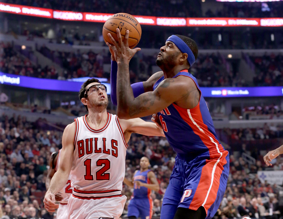 . Detroit Pistons forward Josh Smith (6) shoots past Chicago Bulls guard Kirk Hinrich (12) during the first half of an NBA basketball game Monday, Nov. 10, 2014, in Chicago. (AP Photo/Charles Rex Arbogast)