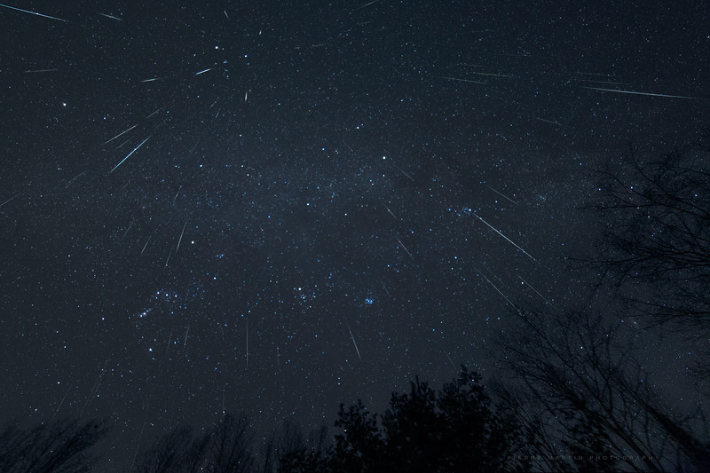 "This is a composite image of the Geminids meteor shower taken with my Canon 6D and a Rokinon 14mm lens at f2.8. I took hundreds of exposures over the night, all while tracking these stars. Then I picked all the shots with meteors in them and digitally added them together into Photoshop to create this image... a near ""all night"" capture of 74 Geminids. This is a really wide view, covering most of the entire sky. The Milky Way is visible across several constellations... including Orion, Taurus and Perseus. All the meteors seem to radiate from a point in Gemini, an effect due to perspective. Those tiny meteors near the radiant point are ones seen coming nearly ""head on"" to the camera.  Taken on December 13/14 2017."