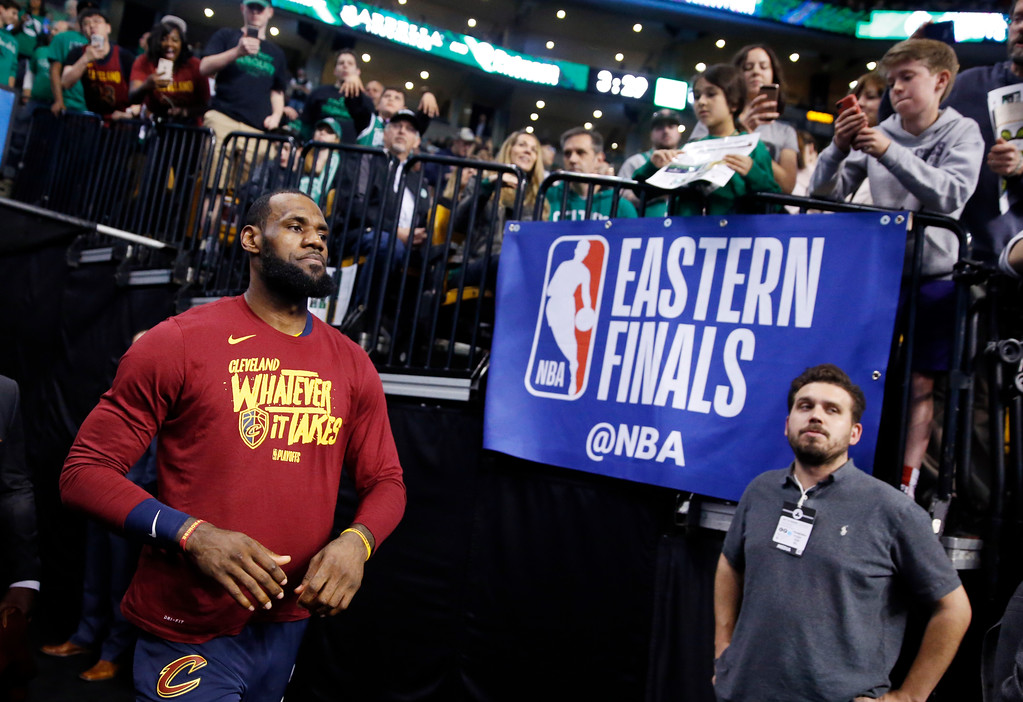 . Fans watch Cleveland Cavaliers forward LeBron James enters the court to warm up before Game 1 of the NBA basketball Eastern Conference Finals against the Boston Celtics, Sunday, May 13, 2018, in Boston. (AP Photo/Michael Dwyer)