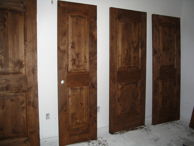 The knotty alder doors are being stained and finished.