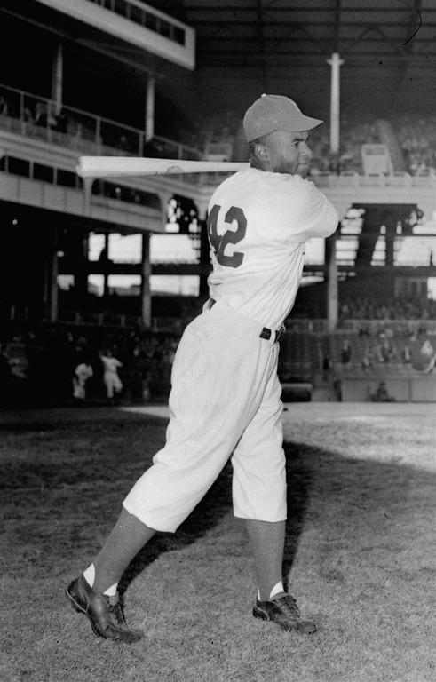 . Jackie Robinson, Brooklyn Dodgers\' first baseman, posed action at Ebbets Field in 1947.  (AP Photo)