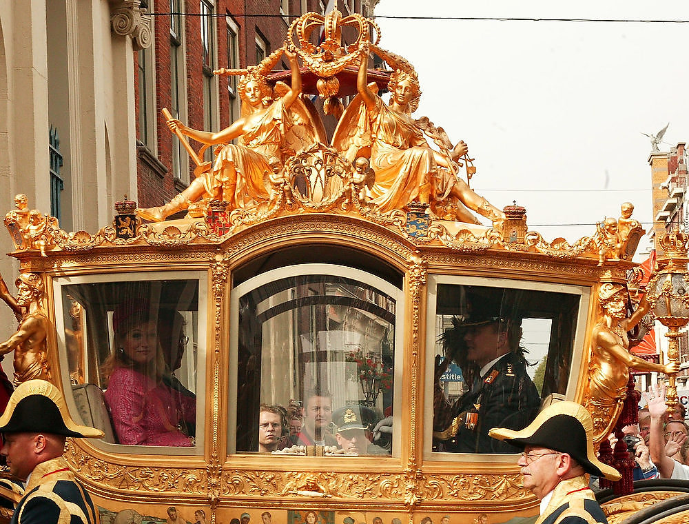 . Princess Maxima, Prince Willem Alexander and Queen Beatrix sit in the golden carriage on their way to Palace Noordeinde September 16, 2003 in The Hague, Netherlands. Queen Beatrix traditionally gives a speech to mark the state opening of parliament in the presence of members of the Dutch government and the rest of the Dutch Royal family at the Binnenhof in The Hague. (Photo by Mark Renders/Getty Images)