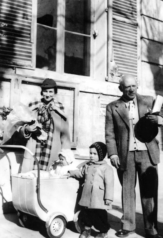 . Spanish painter Pablo Picasso holds the scroll making him an honorary citizen of Vallauris, in south-eastern France, on his way home from the ceremony at town hall, on January 29, 1950. With him are his wife, painter Francoise Gilot, and their children Claude, standing, and Paloma. (AP Photo)