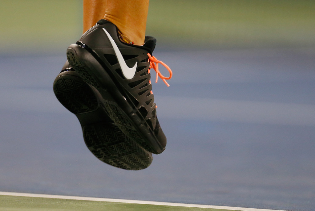 . NEW YORK, NY - AUGUST 27:  Victoria Azarenka of Belarus debuting a new Nike shoe during her women\'s singles first round match against Dinah Pfizenmaier of Germany  on Day Two of the 2013 US Open at the USTA Billie Jean King National Tennis Center on August 27, 2013 in New York City.  (Photo by Mike Stobe/Getty Images for the USTA)