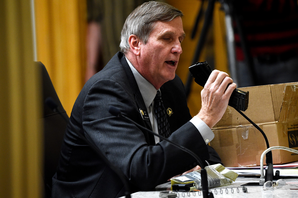 . DENVER, CO. - March 09, 2015: Senator John Cooke of Greeley hold a magazine that can be modified to hold 30 rounds as he speaks to the Senate Judiciary Committee during a hearing for Senate Bill 175, by Republican Senators John Cooke of Greeley and Chris Holbert of Parker at the State Capital; the bill repeals ammunition magazine limits imposed by the 2013 legislature. March 09, 2015 Denver, CO (Photo By Joe Amon/The Denver Post)