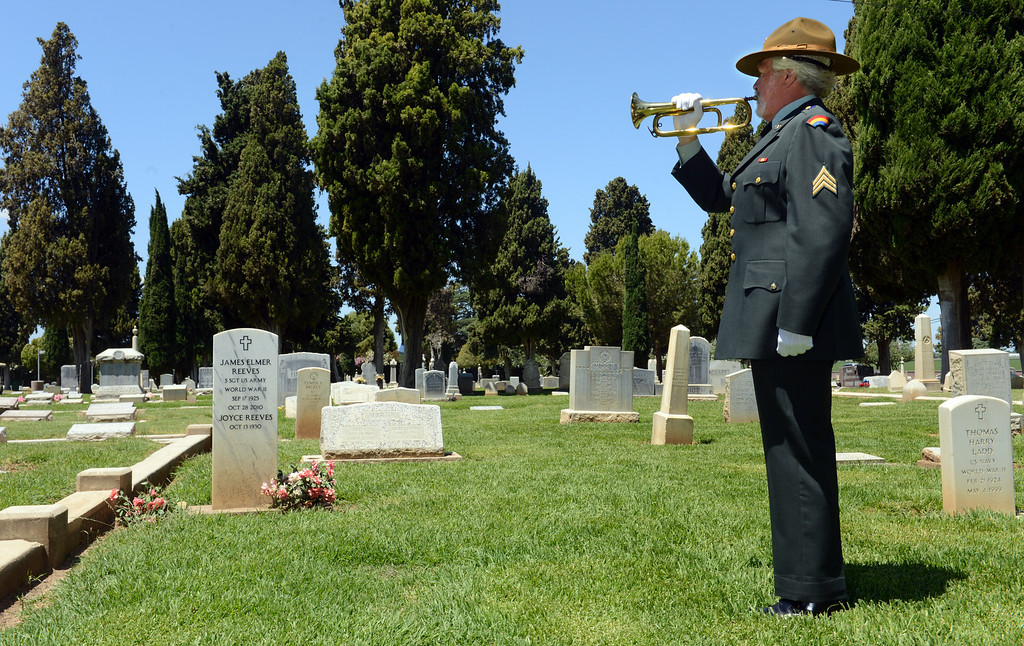 . Dressed in his Army uniform from when he served from 1968-73, Frank Dorritie, a Grammy-winning audio production specialist and Los Medanos Community College teacher plays taps at the Union Cemetery on Thursday, May 23, 2013, in Brentwood, Calif. Dorritie plays bugle for Bugles Across America. His father served with the Infantry 1st Division in North Africa and Sicily and Dorritie says he plays taps at various memorials to honor his memory. (Susan Tripp Pollard/Bay Area News Group)