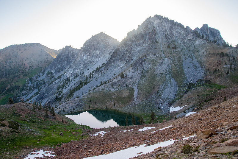 A small lake under craggy peaks in the Trinity Alps Wilderness in northern California.