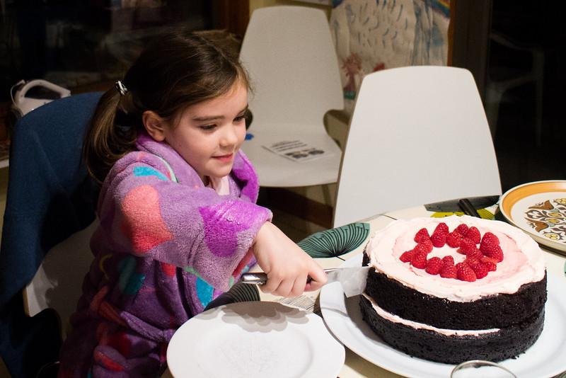 Anya cuts the cake.jpg